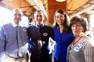Alison Lundergan Grimes poses with the West family during her campaign party at Churchill's in Berea, Kentucky.